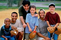 Three mid adult men with three boys smiling