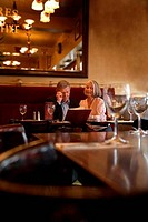 Senior couple sitting at a table in a restaurant