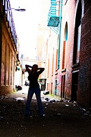 A teen girl standing in an alley in downtown Spokane, Washington, USA
