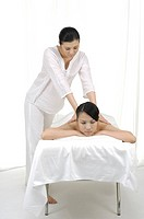Woman getting back massage (thumbnail)