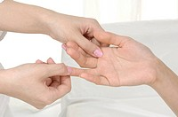 Woman getting finger massage (thumbnail)