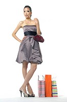 Woman holding a purse and smirking near shopping bags (thumbnail)