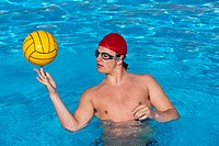 Water Polo player spinning ball on finger tip