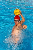 Water Polo player shouts to team mate befroe passing ball