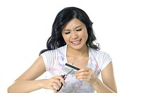 Woman cutting a credit card