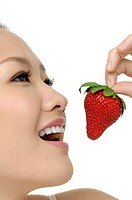 Beautyfull smiling girl with strawberry