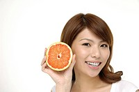 Beautiful woman with grapefruit