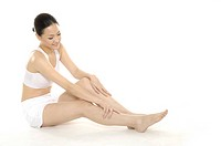 picture of healthy woman legs over white