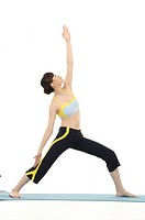 Young Woman who does stretch on white background