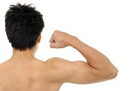Man flexing bicep, close_up