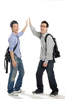 Male university students giving high-five to each other (thumbnail)