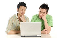 Two male university students using a laptop