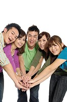 Group of university students stacking hands