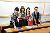 University students smiling in a classroom