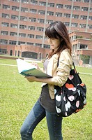 Female university student reading a book (thumbnail)
