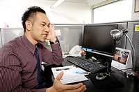 Businessman looking frustrated in an office
