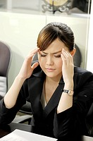 Businesswoman looking depressed in an office