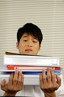 Businessman holding a stack of files