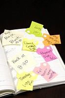 Adhesive notes stuck on a diary