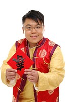 Man holding a Chinese new year couplet