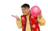 Man holding a balloon and smiling