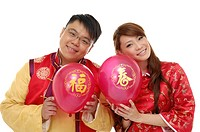 Couple holding balloons and romancing