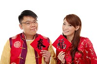 Couple holding Chinese new year couplets