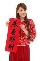 Woman holding a paper of Chinese lucky poem