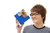 Man holding a gift and smiling