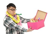Man opening a gift box and looking surprised