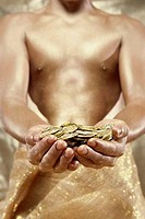 Person holding gold coins