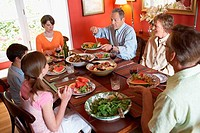 High angle view of a family sitting at a dining table
