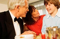 Close_up of grandparents smiling with their grandson