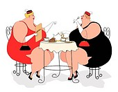 Two overweight women having tea and cake