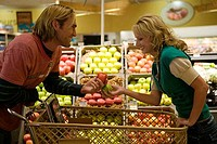 Young couple buying fruit in a supermarket
