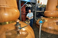 Tobermory Whisky Distillery, Isle of Mull  Scotland  Still man Ruairaidh Currie  Traditional copper pot stills in the Still Room