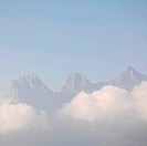 Three Sisters Mountain with morning clouds rising above Canmore CANADA Alberta
