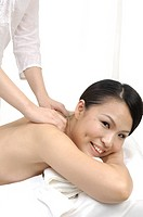 Close_up of a woman getting back massage