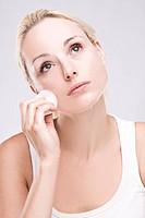 Beautiful blonde removing facial make_up