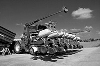 Tractor with seeder before sowing of maize