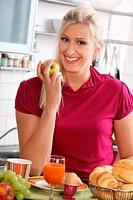 Blond woman having healthy breakfast, portrait