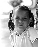 Portrait of girl smiling outdoors