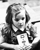 Close_up of a schoolgirl holding a paper