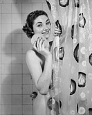 Young woman showering and smiling