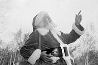 Father christmas pointing up at sky