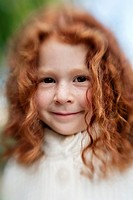 Portrait of 5 year old girl with red hair, shot with lensbaby for blur and distortion