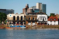Looking across the River Thames to the Rutland and Blue Anchor pubs at Hammersmith, London, UK