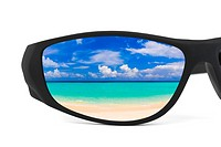 Sunglasses and seascape reflection