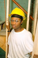 Portrait of a black teen volunteer carpenter rehabbing the community youth center  St Paul Minnesota MN USA
