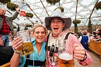 Tourists enjoying beer during Oktoberfest festival, Munich, Bavaria, Germany